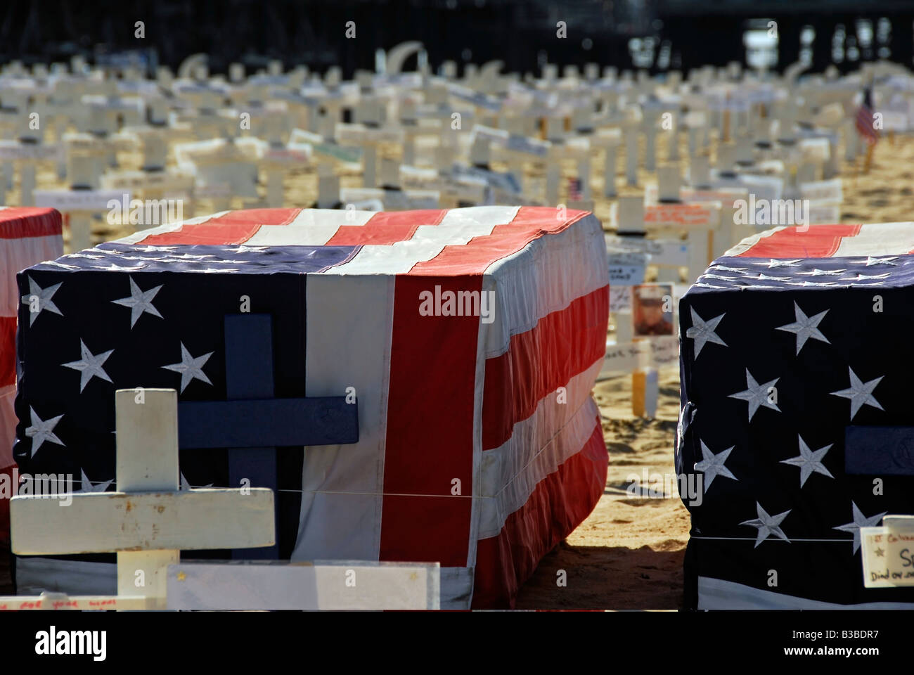 Arlington West memorial, Santa Monica Beach, California, CA Wooden Cross, Star of David, crescents and Flag draped - Stock Image