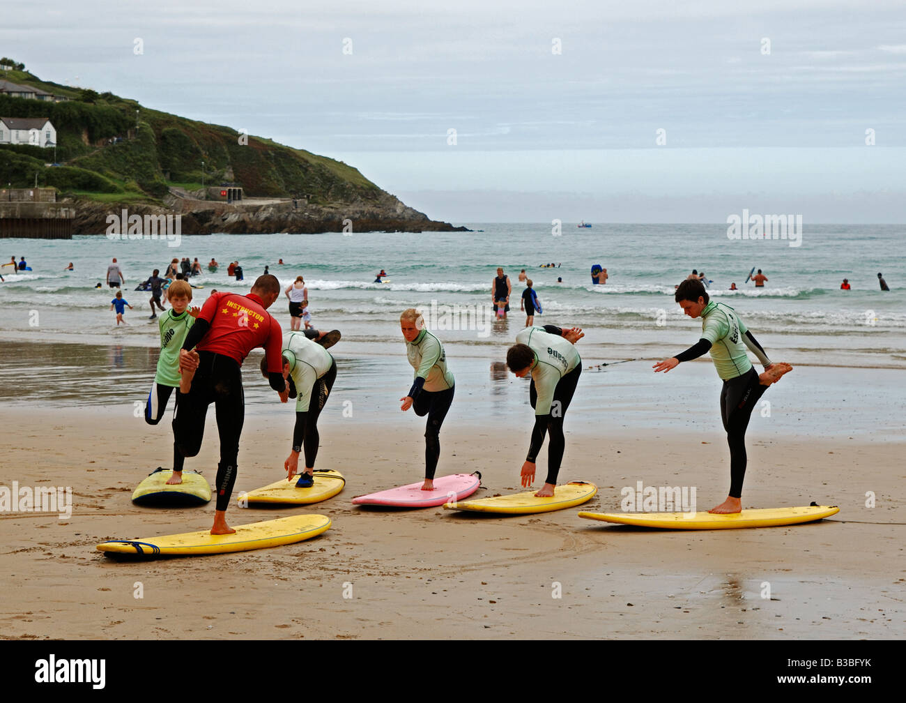 teenagers attending a surf school at newquay in cornwall,england,uk - Stock Image