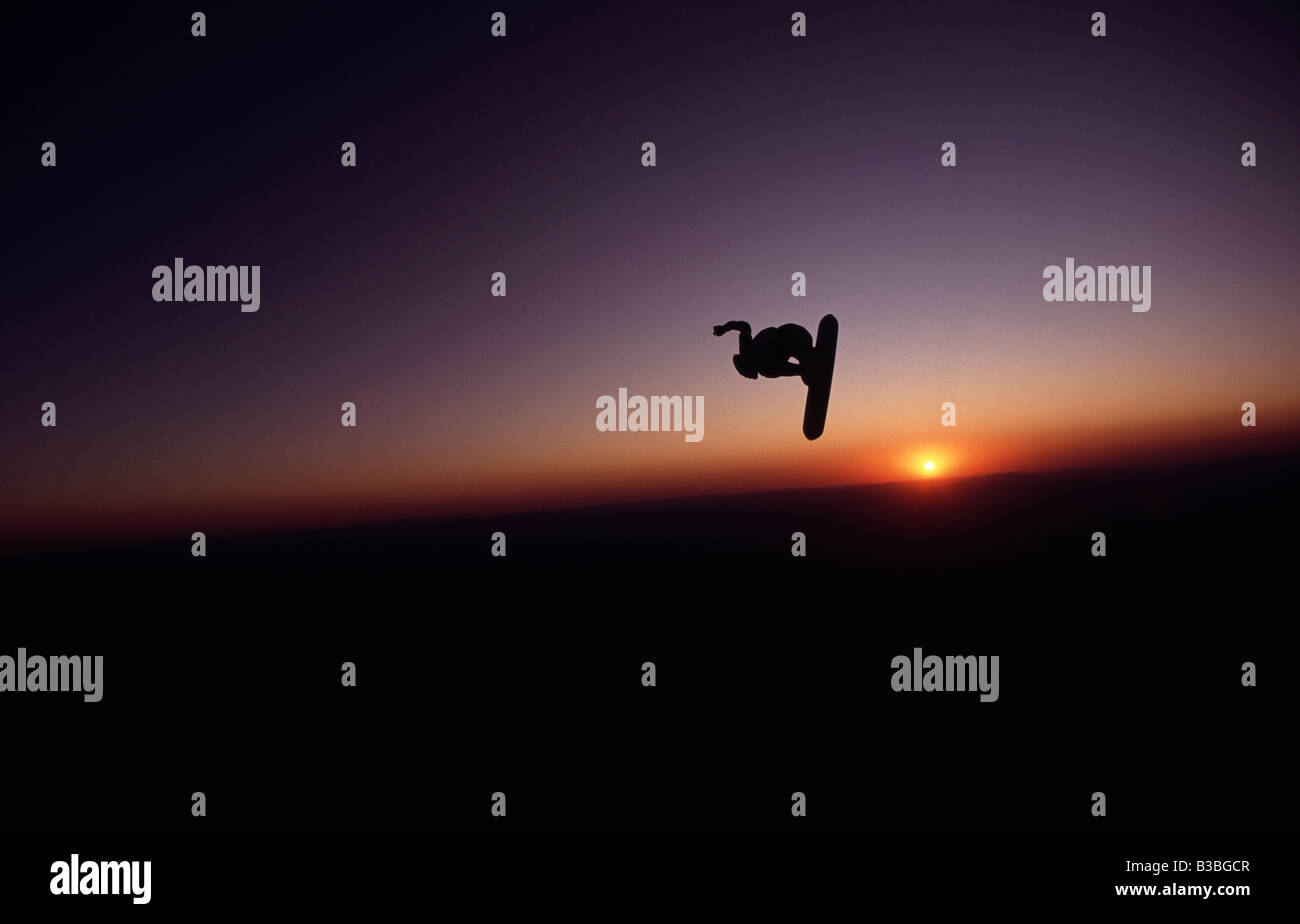 A Skysurfer uses the last bit of daylight to surf through the Arizona sky - Stock Image