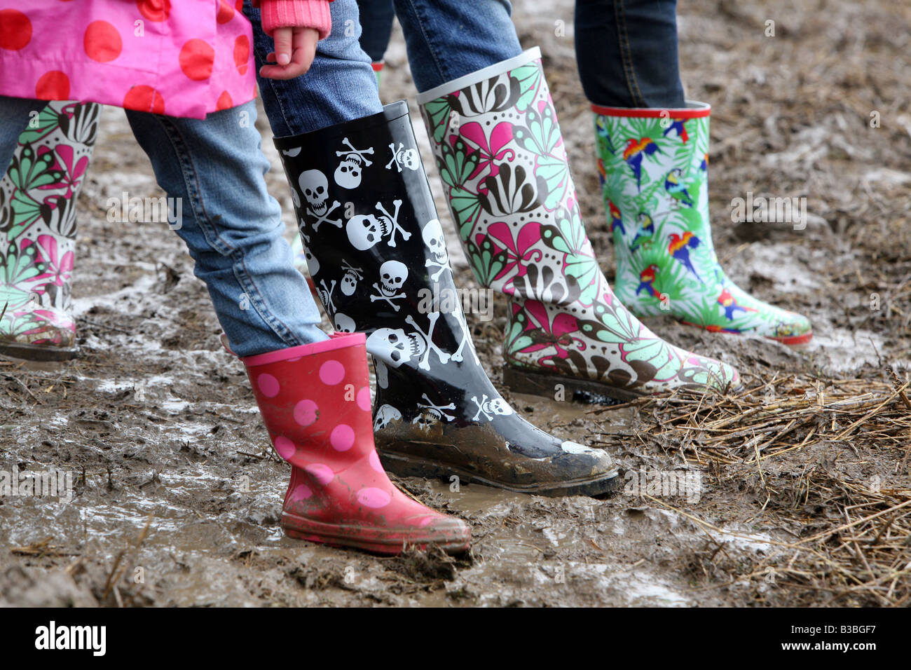 Colourful wellington boots in the mud