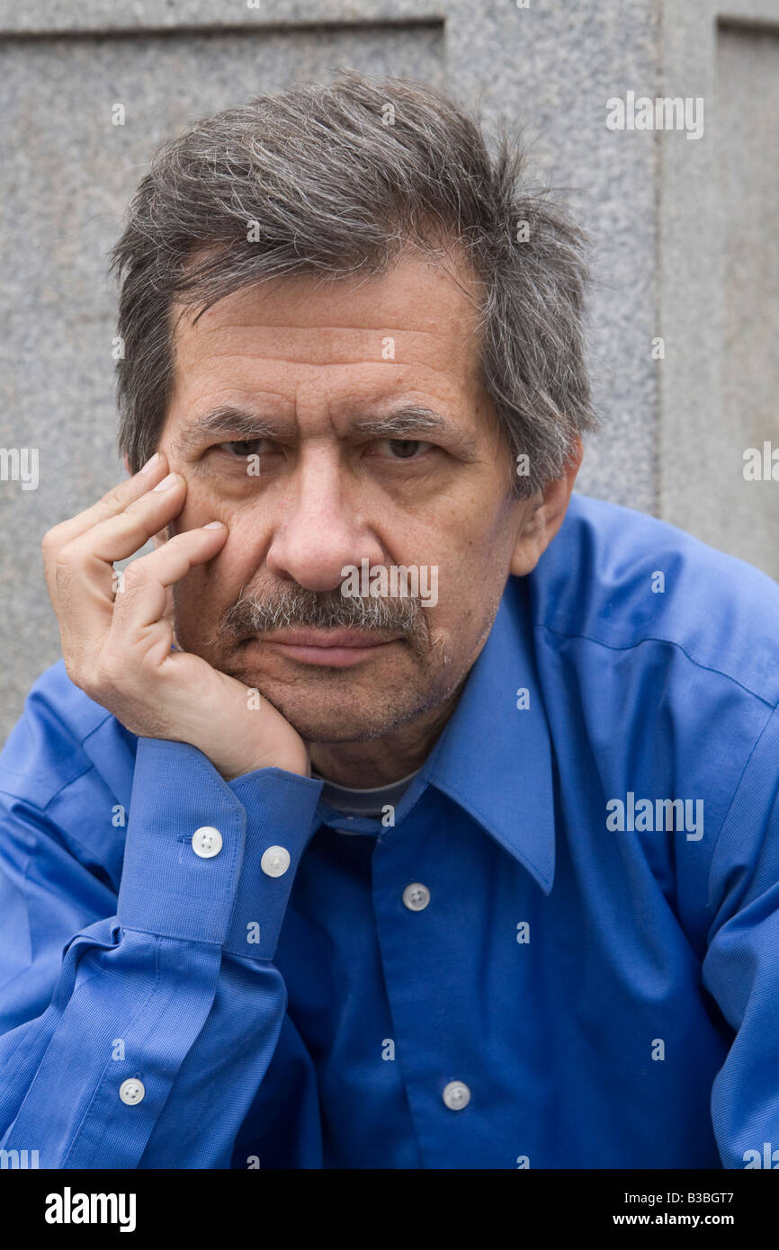 Man in his early sixties out of work figuring out what to do next for work MR - Stock Image