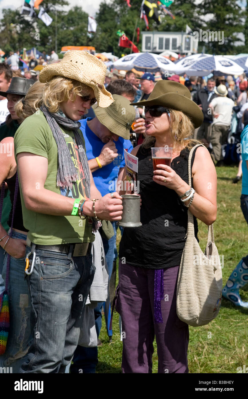 two generations of Festival goers Fairport's Cropredy Convention music festival 2008 near Banbury England UK - Stock Image