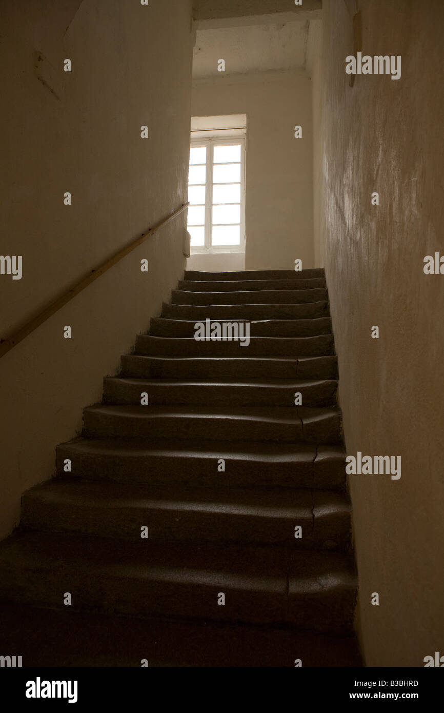 window at top of a flight of stairs - Stock Image