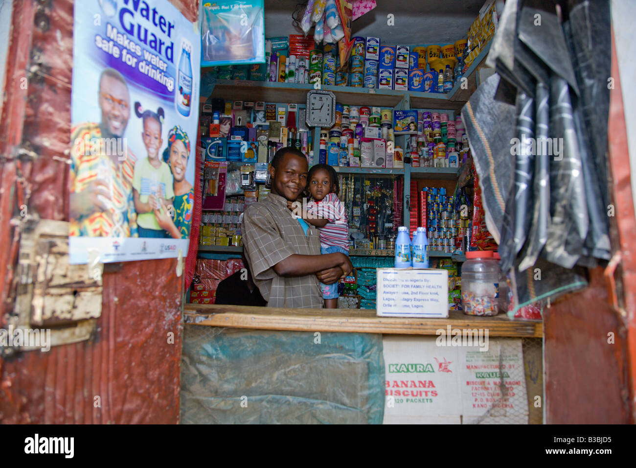 A shop in the Gyadi Gyadi area of Kano Nigeria prominently displays a Waterguard advertisement on the door - Stock Image