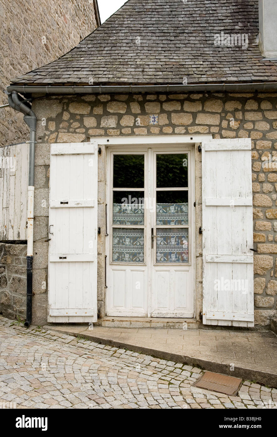 Traditional French Style Door With Shutters And Lace