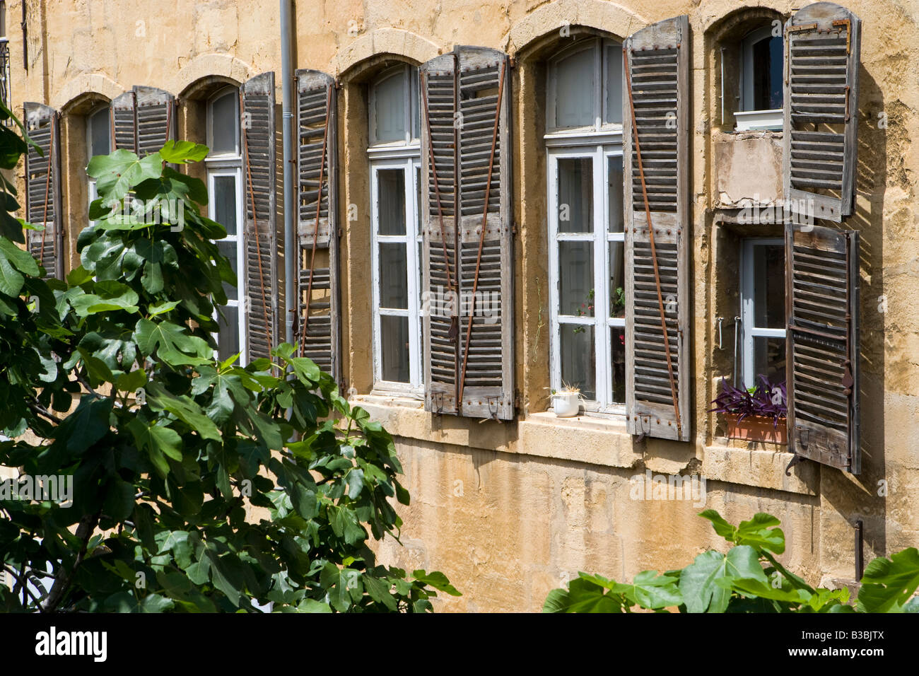 Stone Aix En Provence shutters on a stone house in aix en provence france stock