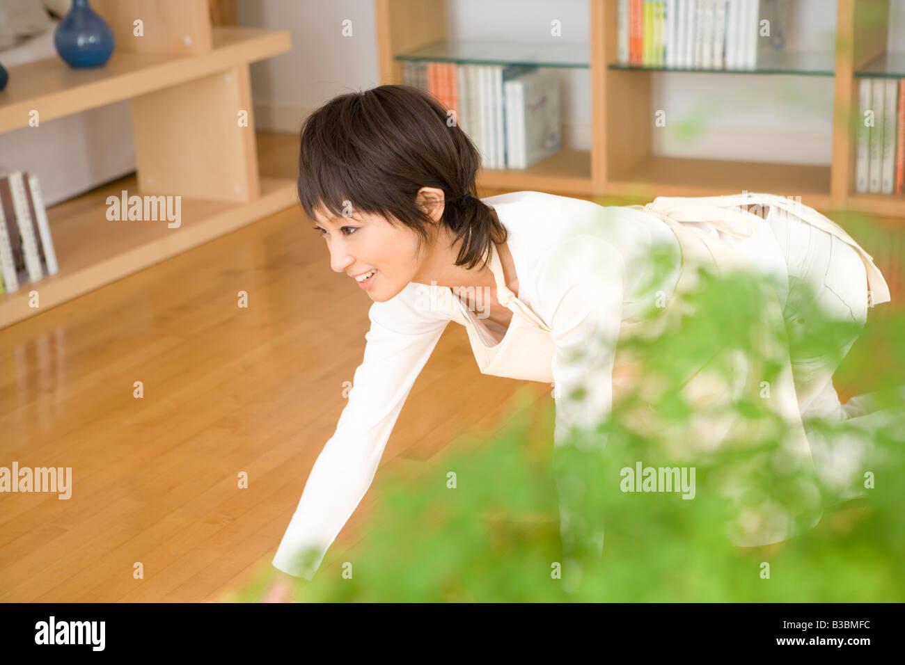 Housewife wiping floor - Stock Image