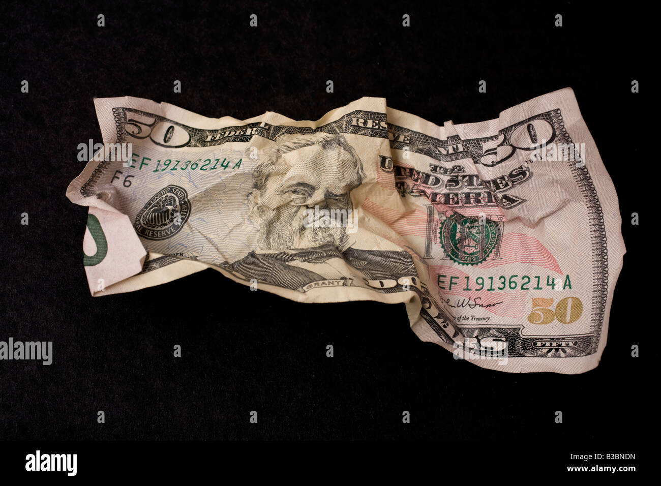 Crumpled $20 US bill - Stock Image
