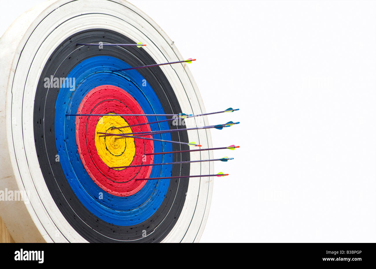 great image of a archery target full of arrows - Stock Image