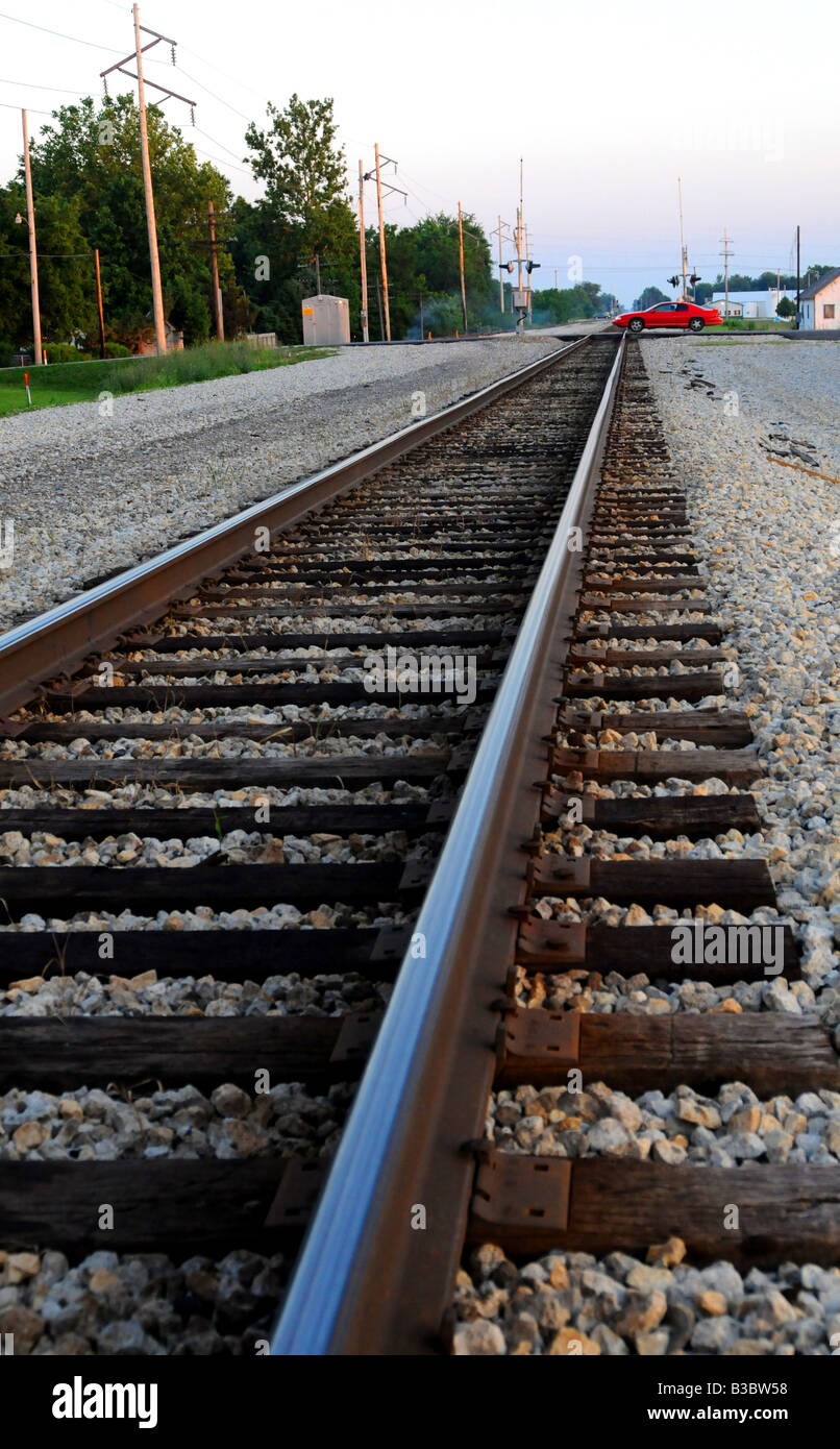 Rural railroad tracks for passenger and freight trains, rail travel - Stock Image