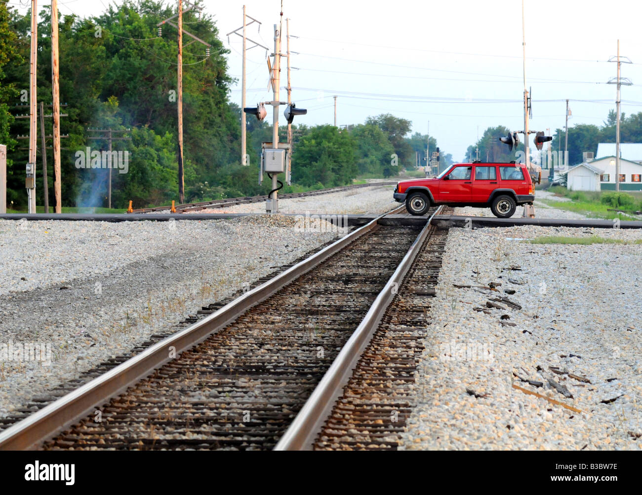 Crossing the railroad tracks safely - Stock Image