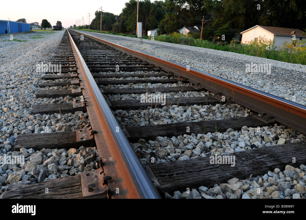 Railroad tracks in a small rural town - Stock Image