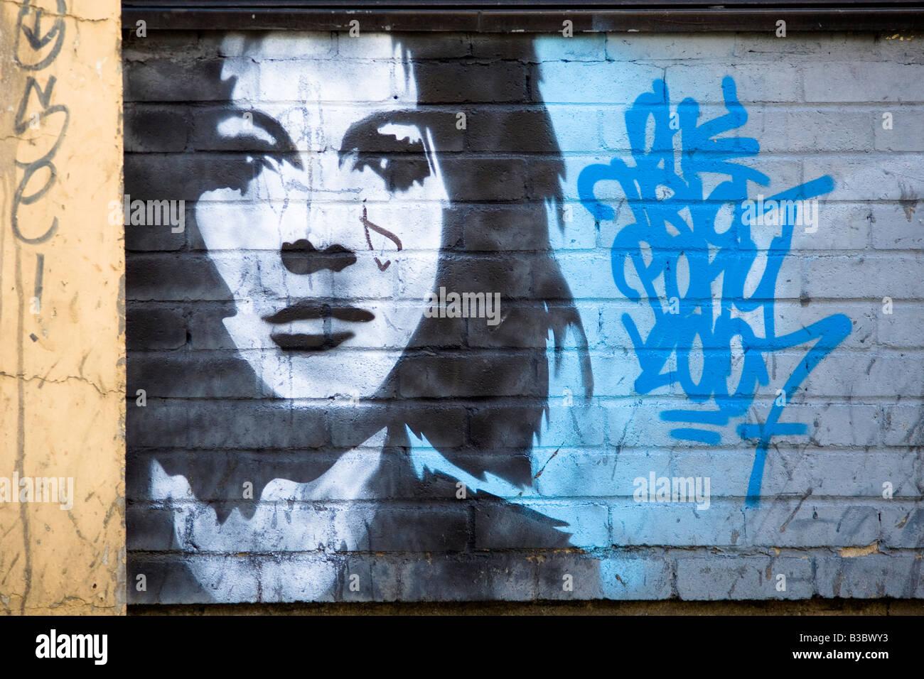 Graffiti stencil of woman's face. Hanbury Street, Tower Hamlets, London, England - Stock Image
