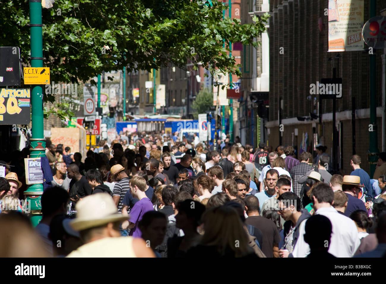 Crowd in Brick Lane Market. Shoreditch, London, England - Stock Image