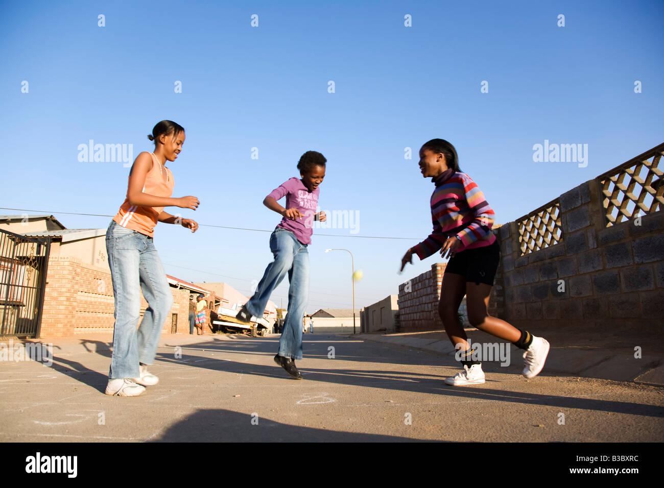 Girls playing on street - Stock Image