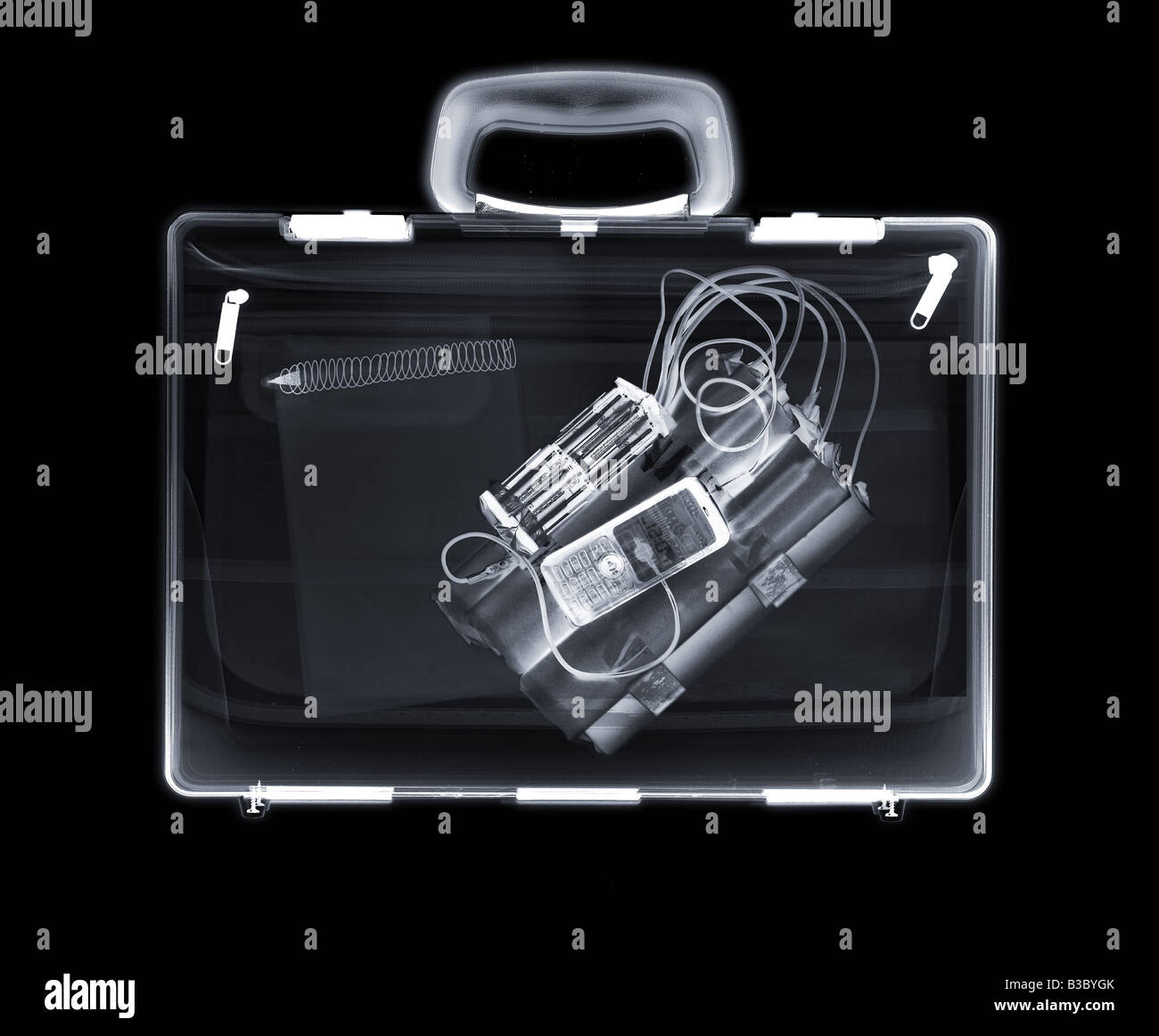X-ray of a bag containing a bomb and a notepad - Stock Image