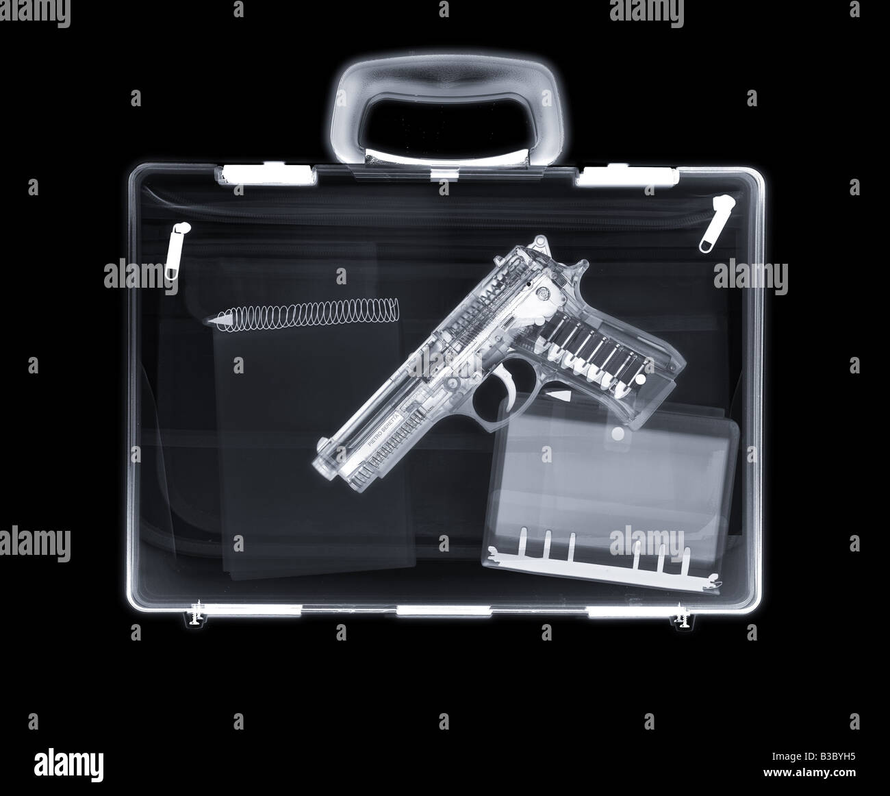 X-ray of a bag containing a gun, filofax and notepad - Stock Image