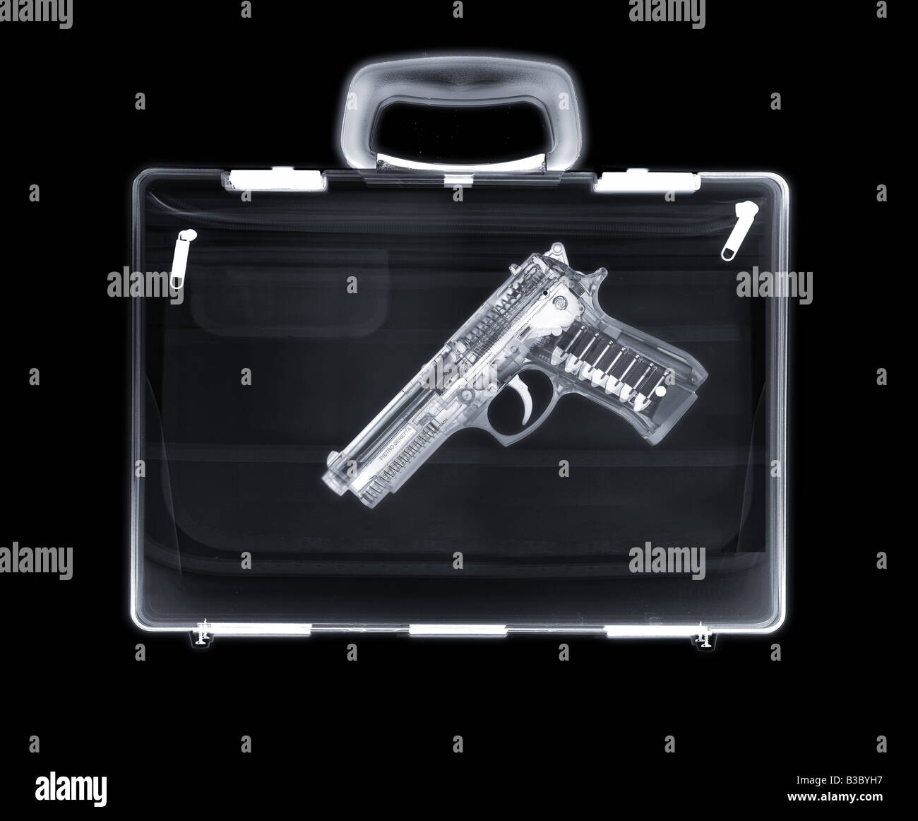 X-ray of a bag containing a gun - Stock Image