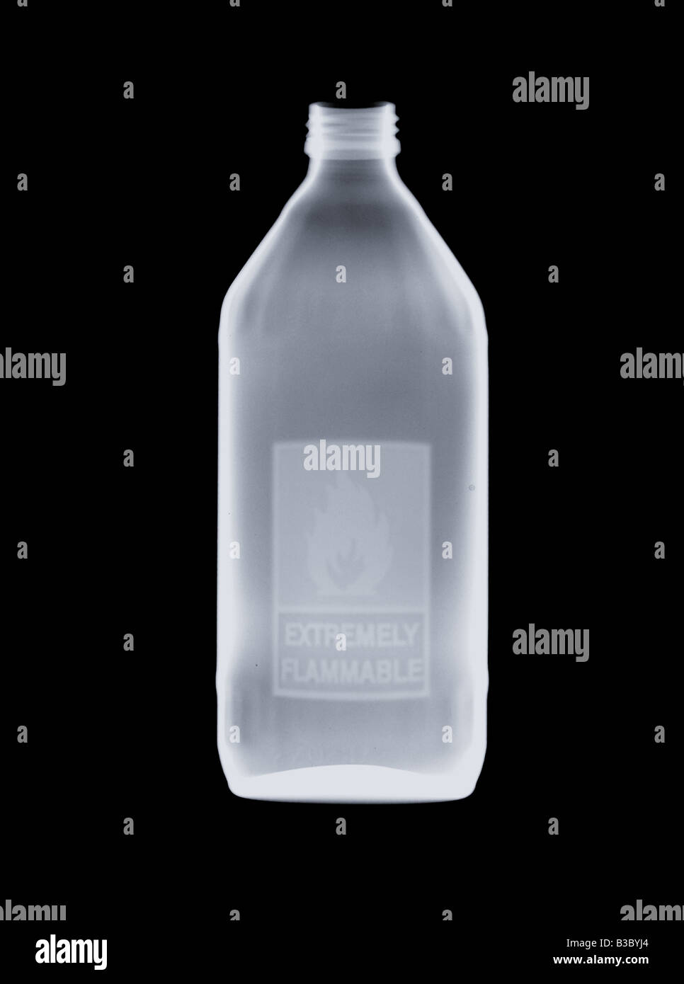X-ray of a bottle of flammable liquid - Stock Image