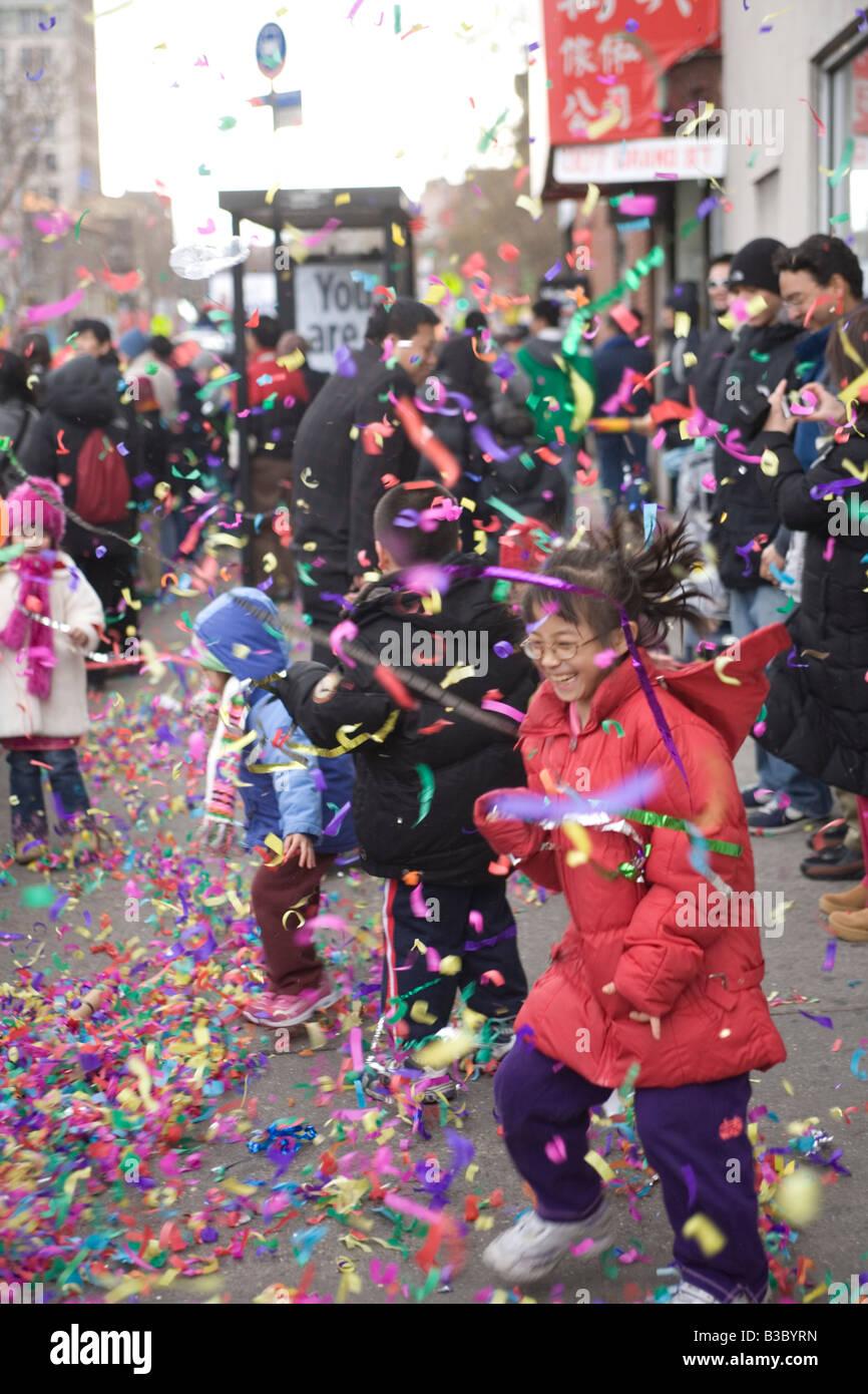 Children love the festivities of Chinese New Year in Chinatown New York City - Stock Image
