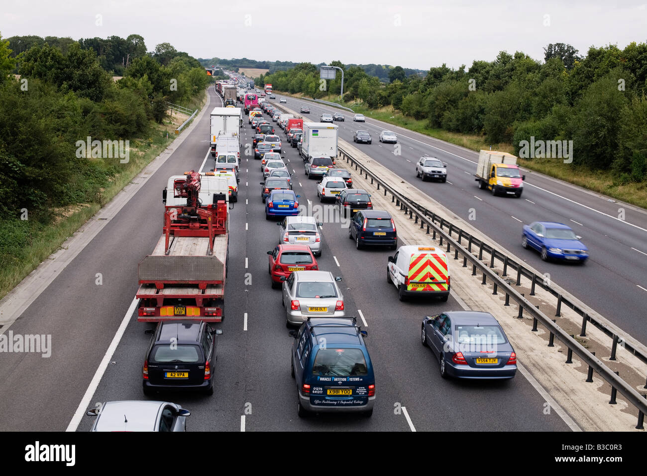Traffic congestion due to an accident on the M11 motorway heading north between J7 Harlow and J8 Stansted Airport - Stock Image