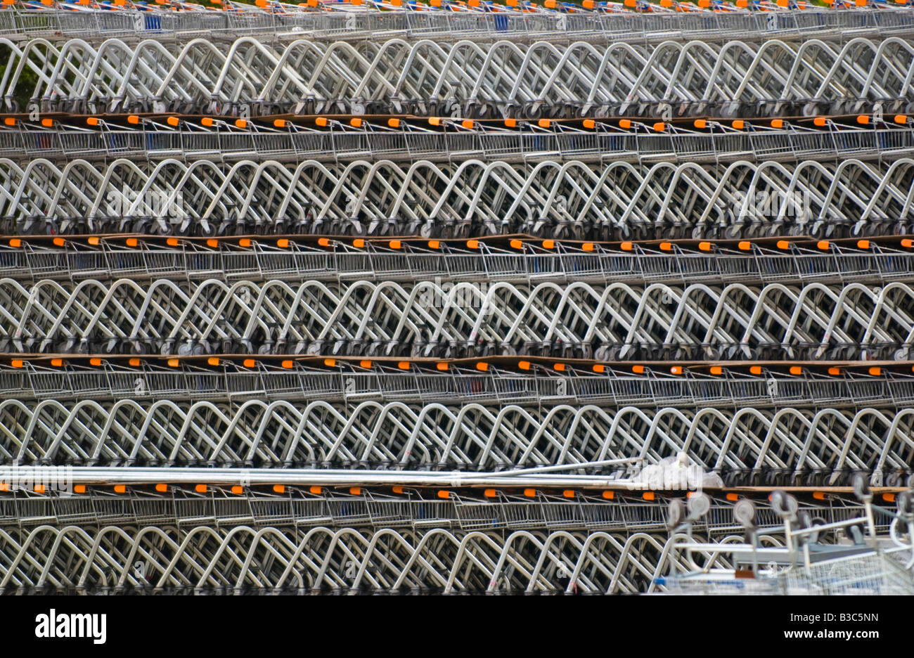 Stacked shopping trolleys waiting dispatch to supermarkets UK - Stock Image