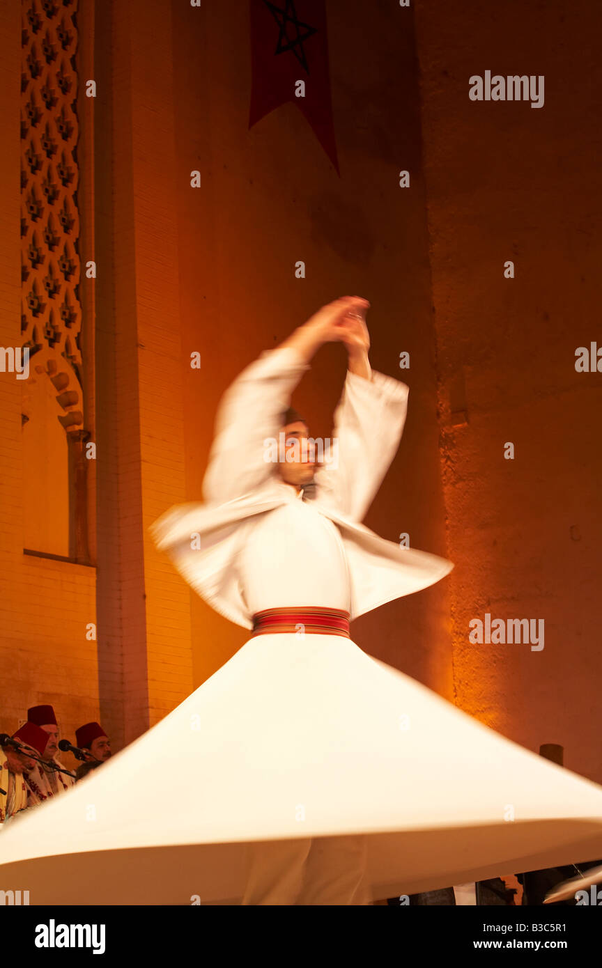 Morocco, Fes. A whirling Dervishe performs on the stage at the Bab Makina during a concert at the Fes Festival of - Stock Image