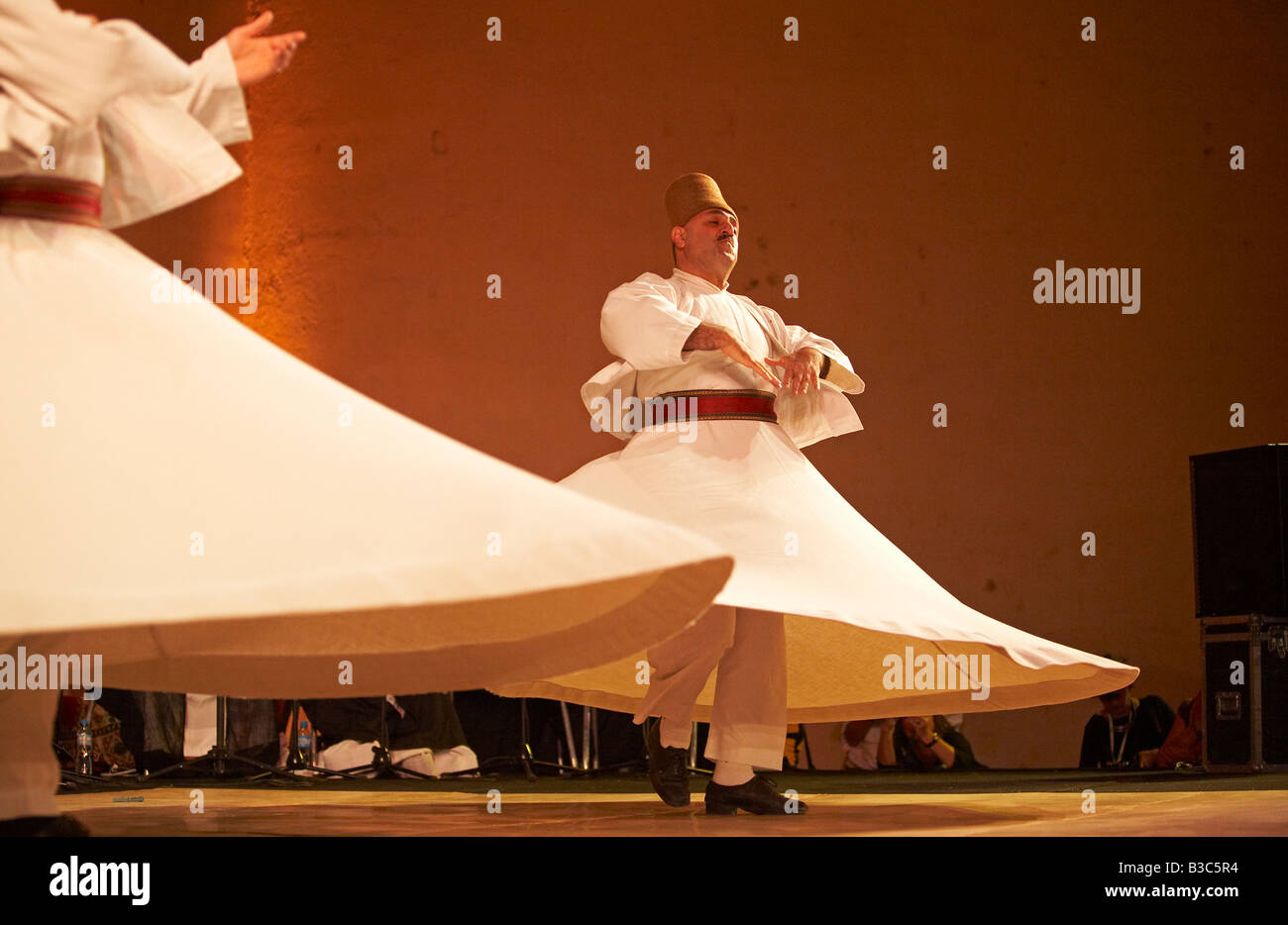 Morocco, Fes. Two whirling Dervishes perform during a concert at the Fes Festival of World Sacred Music. Members - Stock Image