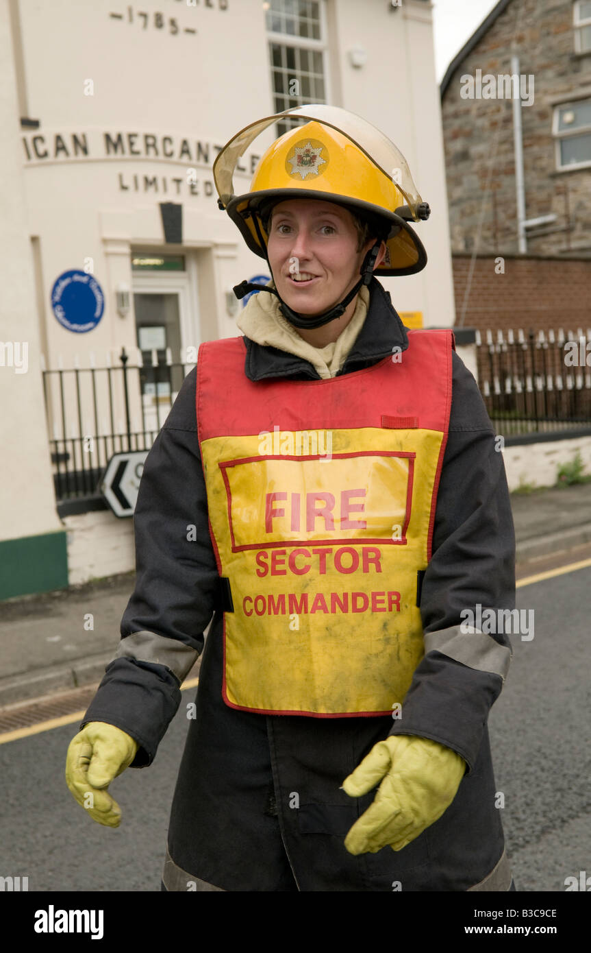 Fire brigade attending an incident at Cardigan west wales UK -  woman Fire Sector Commander in charge - Stock Image