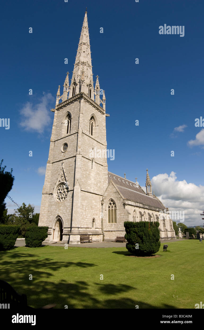 The Victorian marble church Bodelwyddan North Wales UK, with imposing spire, blue sky summer afternoon - Stock Image