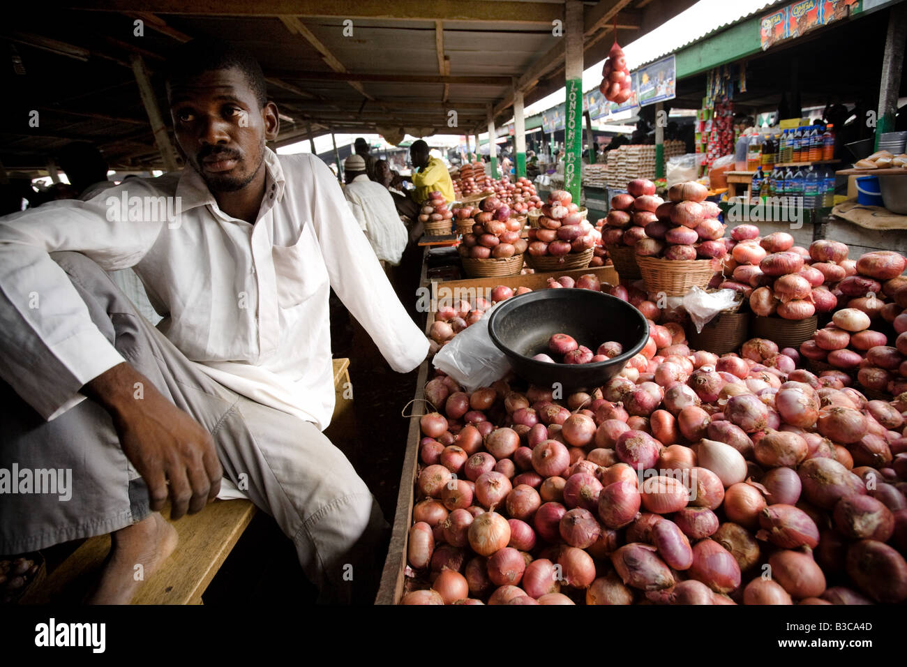 Onion vendor at Agbogboloshie market in Accra Ghana - Stock Image