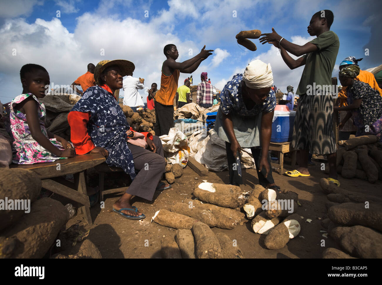 Yam vendors at Agbogboloshie market in Accra Ghana - Stock Image