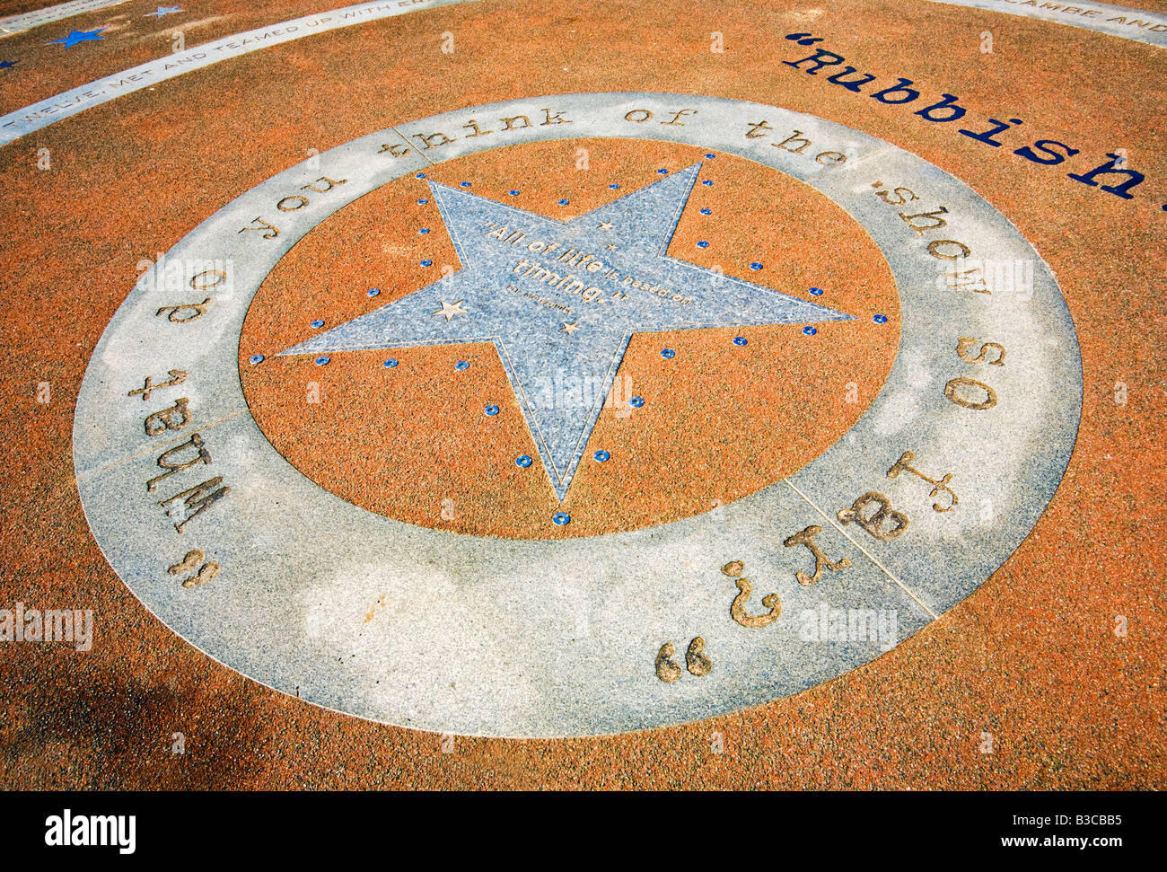 Inscribed showbiz star with quotes at the Eric Morecambe bronze statue memorial at Morecambe, Lancashire, England, - Stock Image