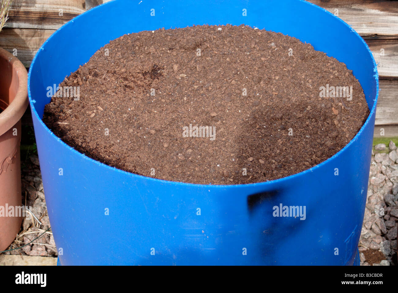 Old fertilizer barrel cut in half and used for growing vegetables in ...