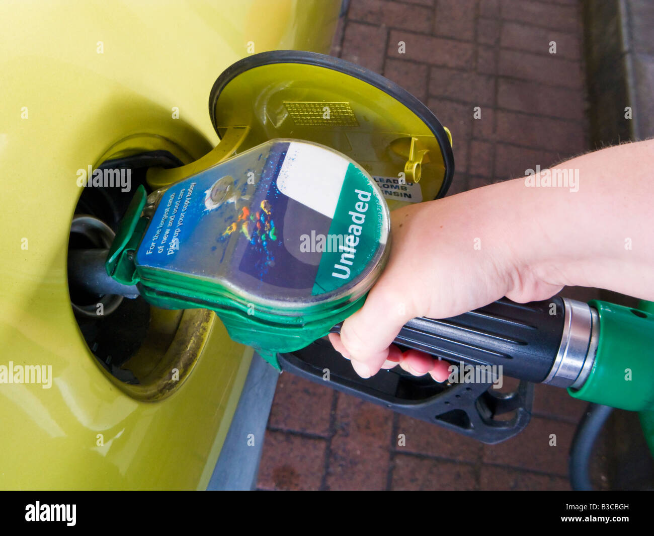 Filling a car at an unleaded petrol pump England UK - Stock Image