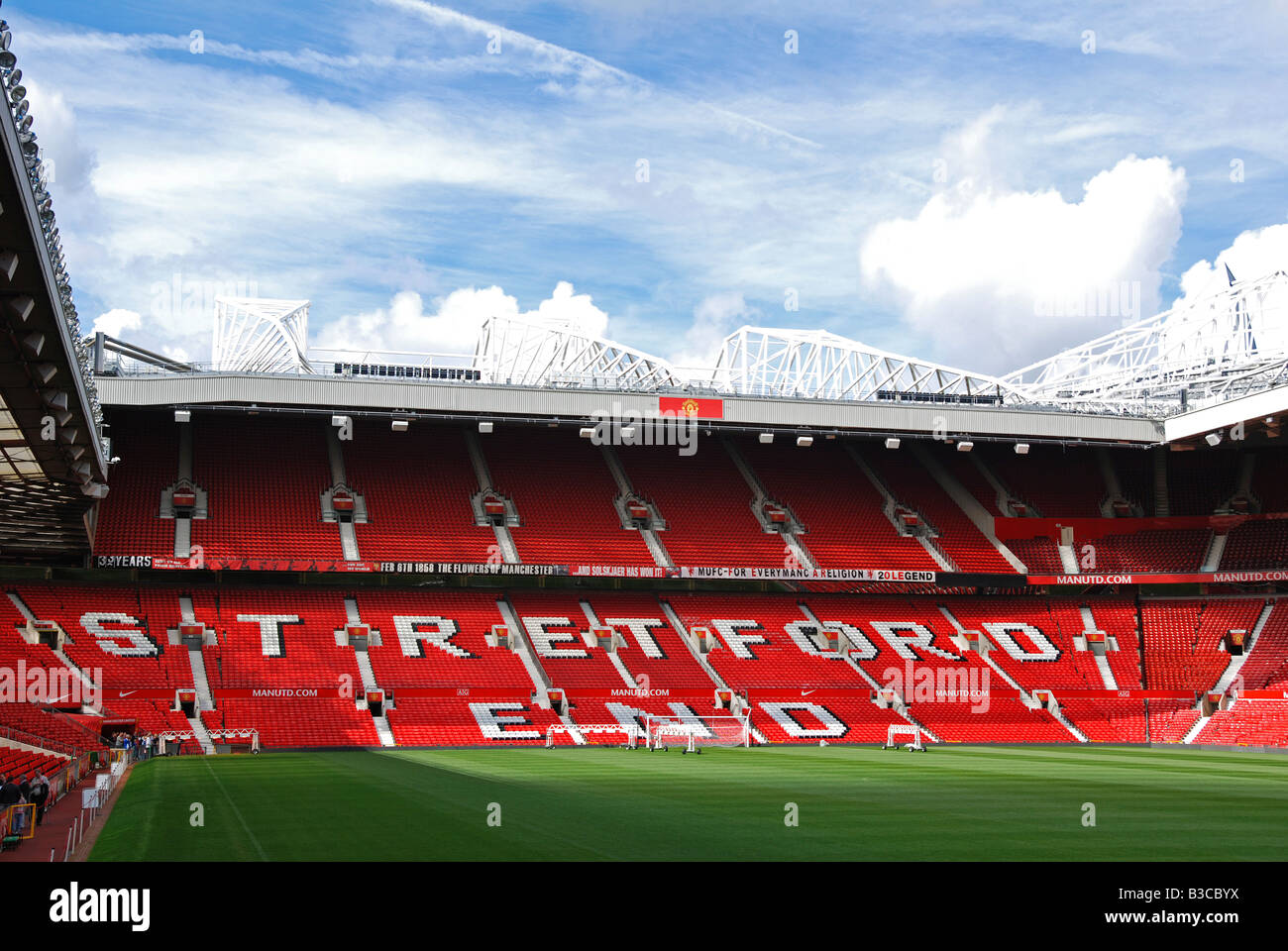 inside an empty 'stretford end' at Old Trafford the home of Manchester United football in England,UK - Stock Image