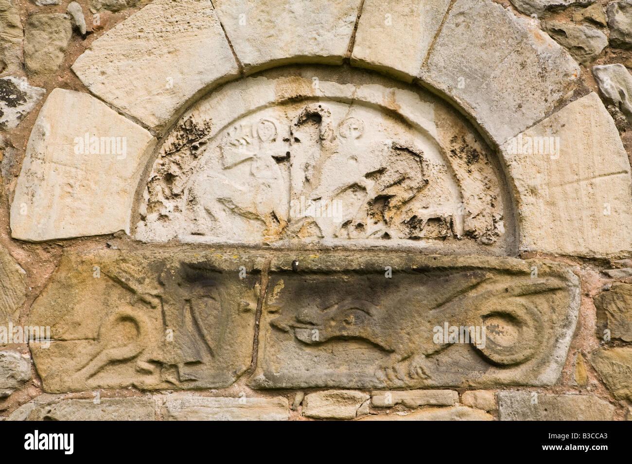 UK Derbyshire Chesterfield Ault Hucknall St John the Baptist old Saxon church door lintel detail - Stock Image