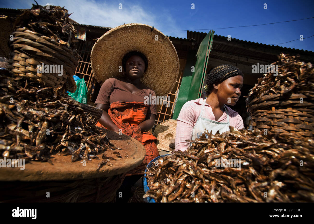 Dried fish vendors at Agbogboloshie market in Accra Ghana - Stock Image
