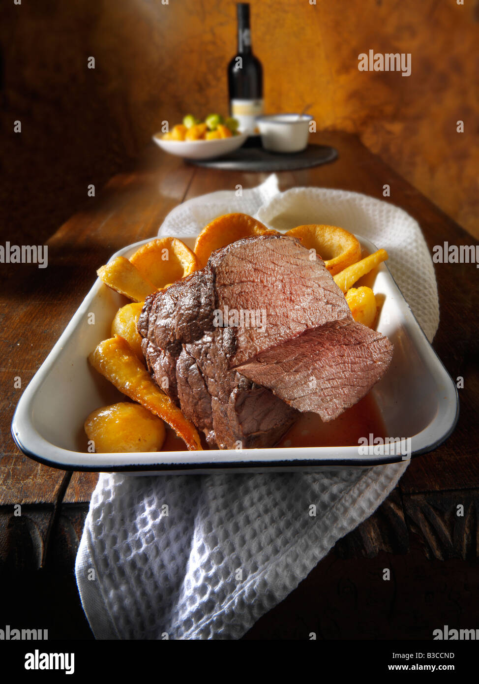 Traditional British roast beef joint, hung for 21 days, roast potatoes, yorkshire puddings - Stock Image