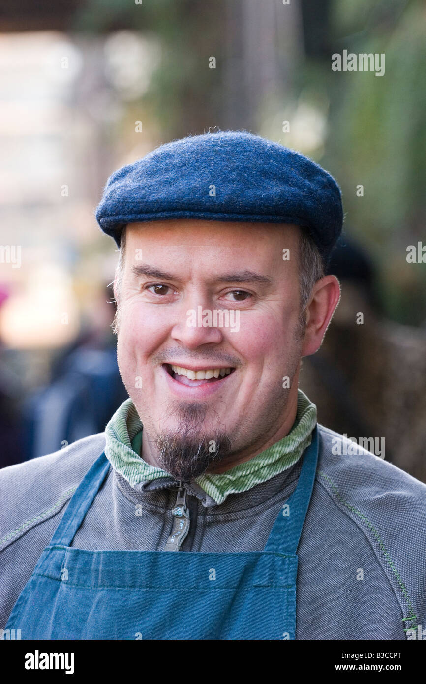 Mature man smiling, portrait, close-up - Stock Image