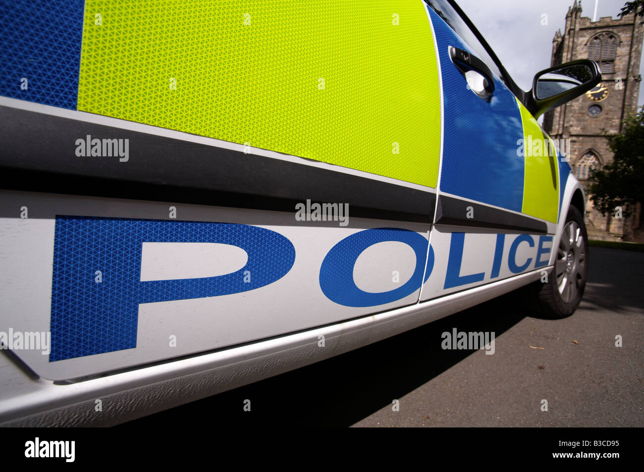 close up of the livery of a police car parked outside a church - Stock Image