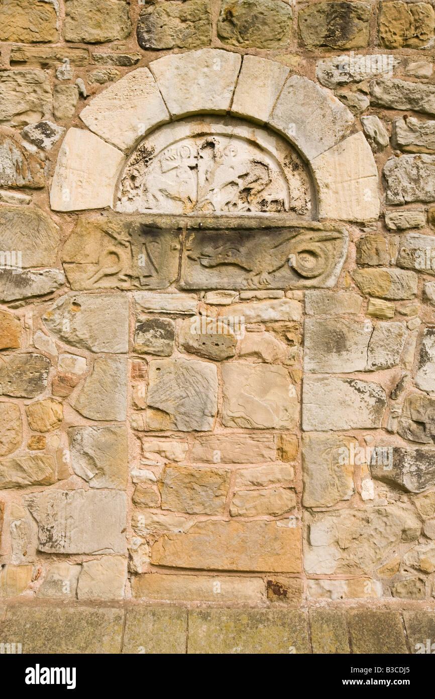 UK Derbyshire Chesterfield Ault Hucknall St John the Baptist old Saxon church door lintel - Stock Image