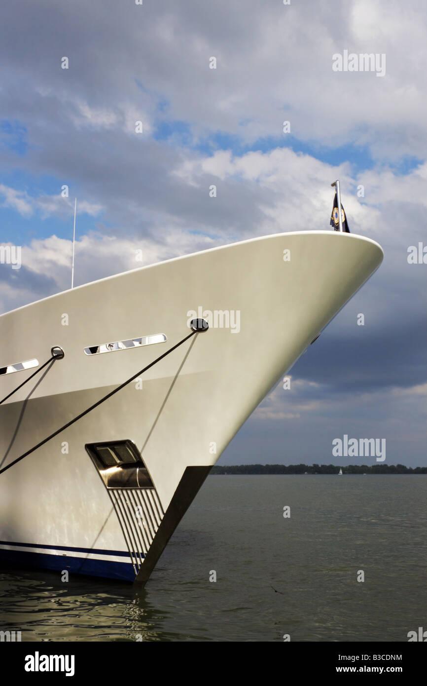 Luxury yacht Blue Moon in Queen's Quay Toronto under moody sky - Stock Image