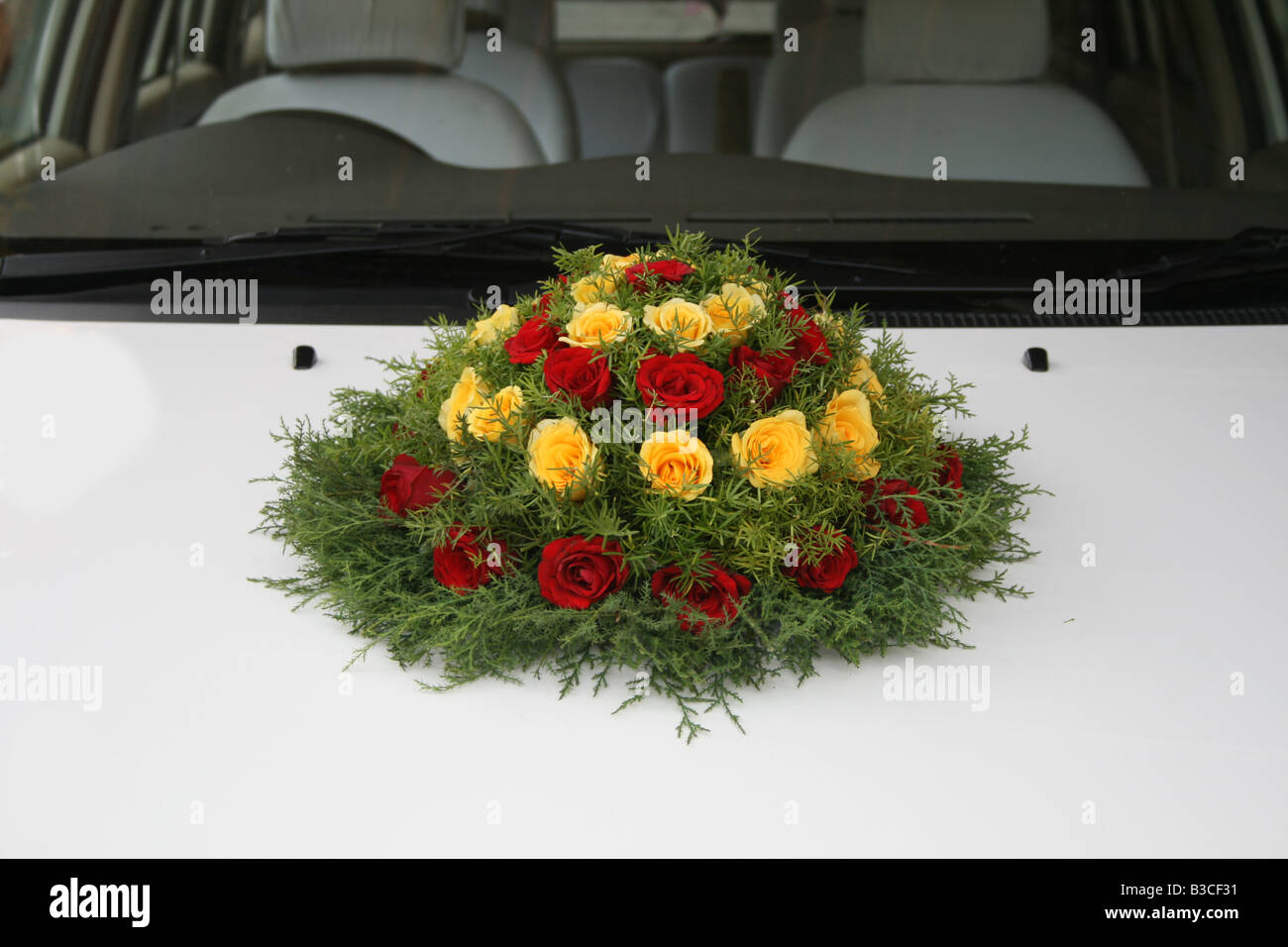 Wedding Bouquet Decorated On White Car For Bridegroom And Bride On
