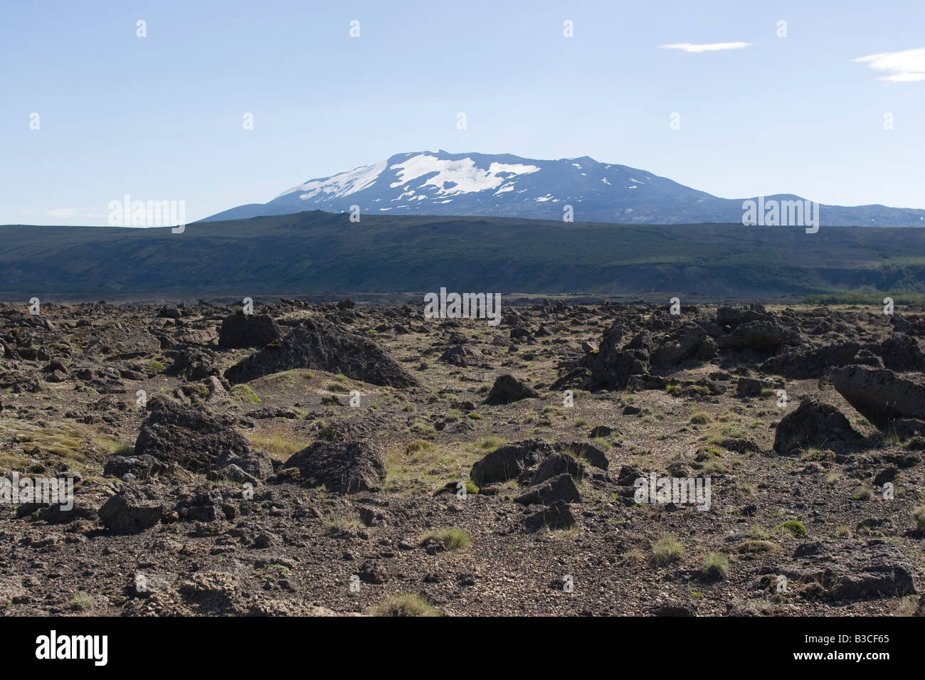 Lava field and Hekla active volcano, Iceland - Stock Image