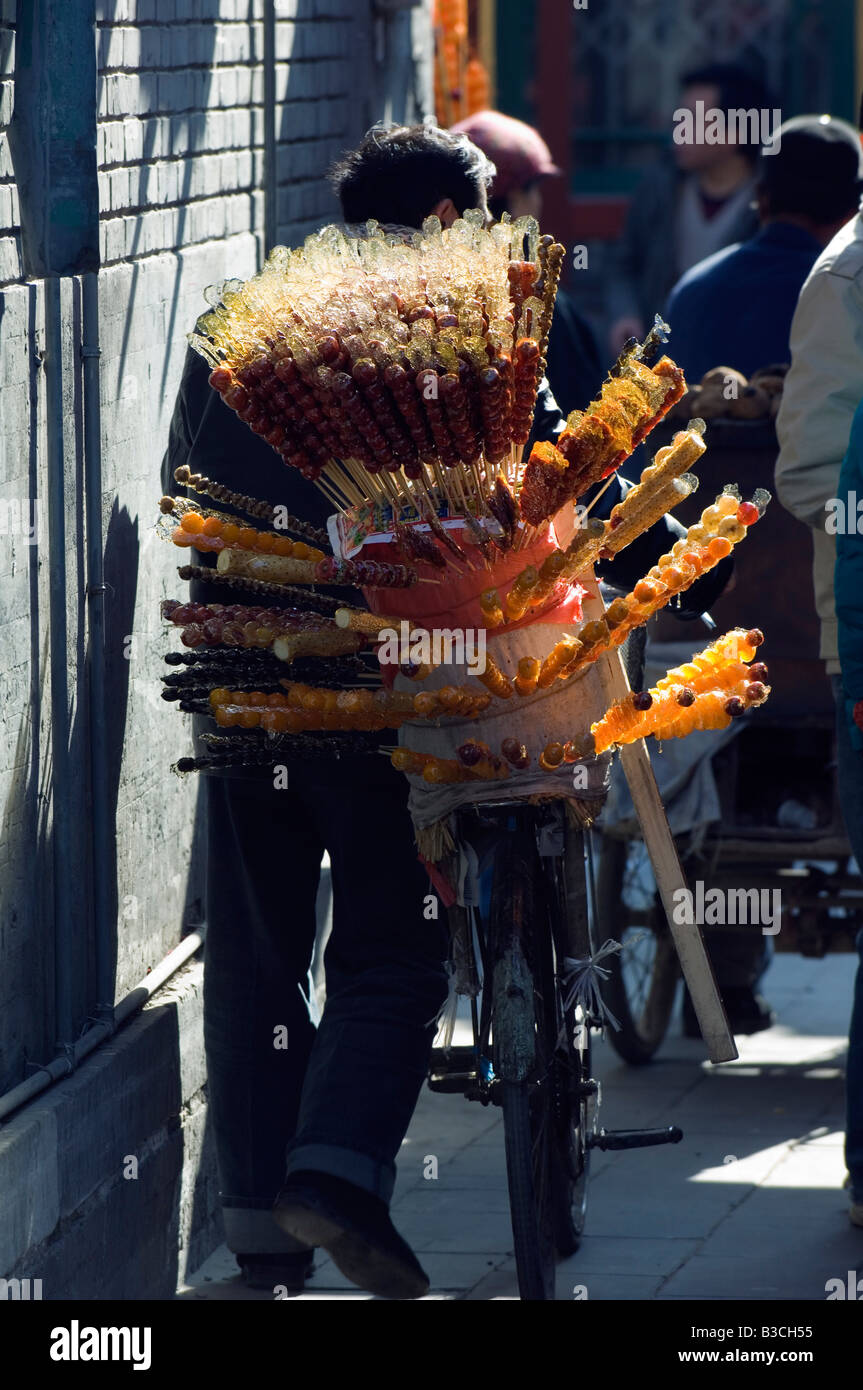China, Beijing. Candy seller in a local neighbourhood hutong. - Stock Image