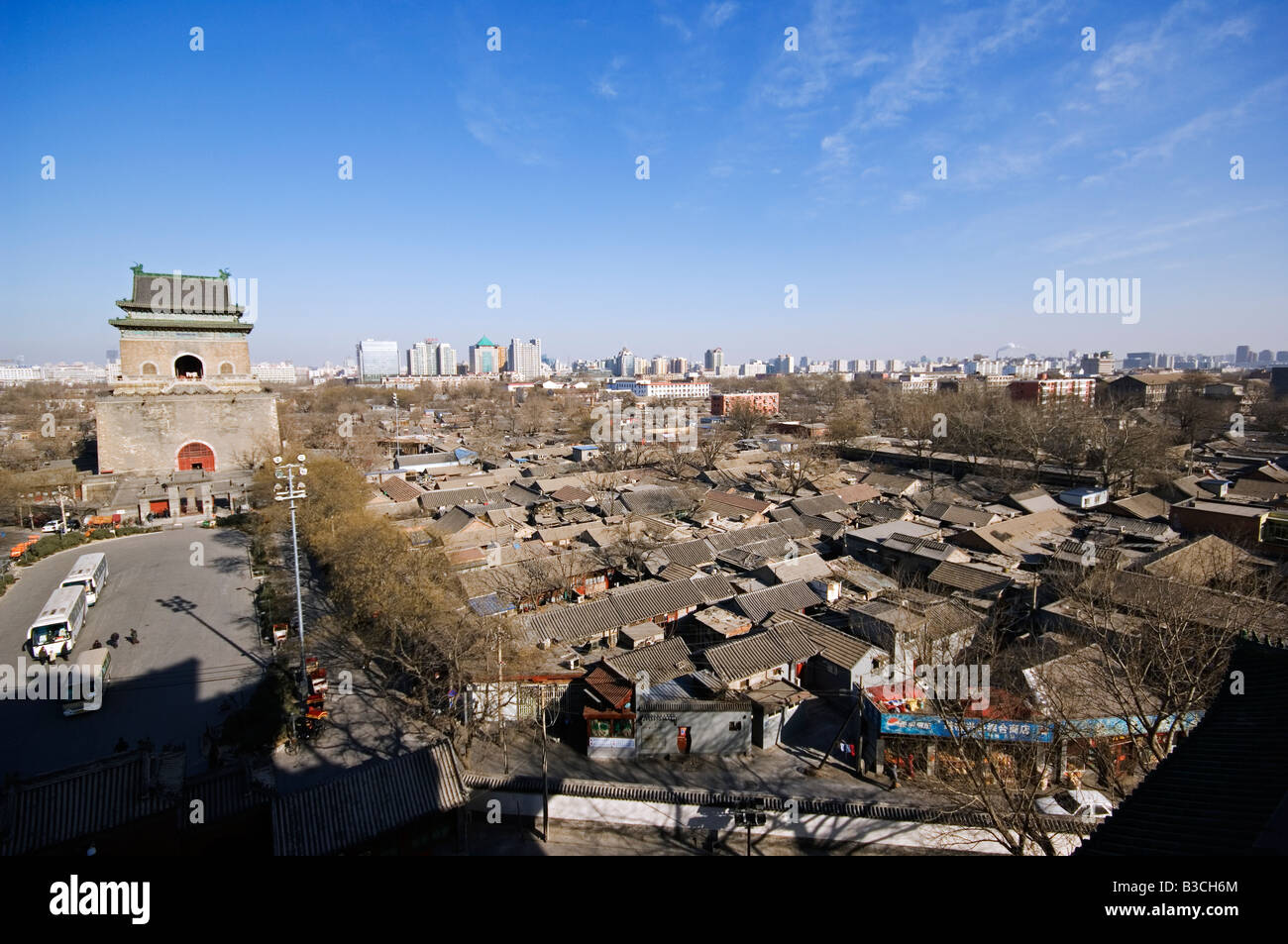China, Beijing. Bell Tower and hutong neighbourhood rooftops. - Stock Image