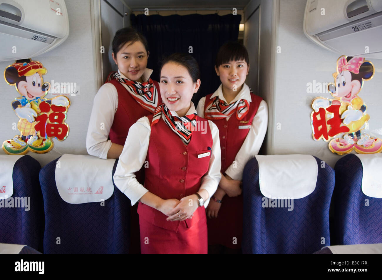 China, Beijing. Chinese New Year - Flight attendants on a New Years Eve flight carrying passengers back to their - Stock Image