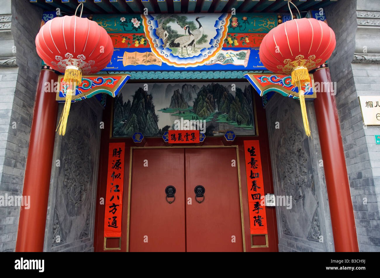 China, Beijing. Chinese New Year Spring Festival - lantern decorations on a hutong house. - Stock Image