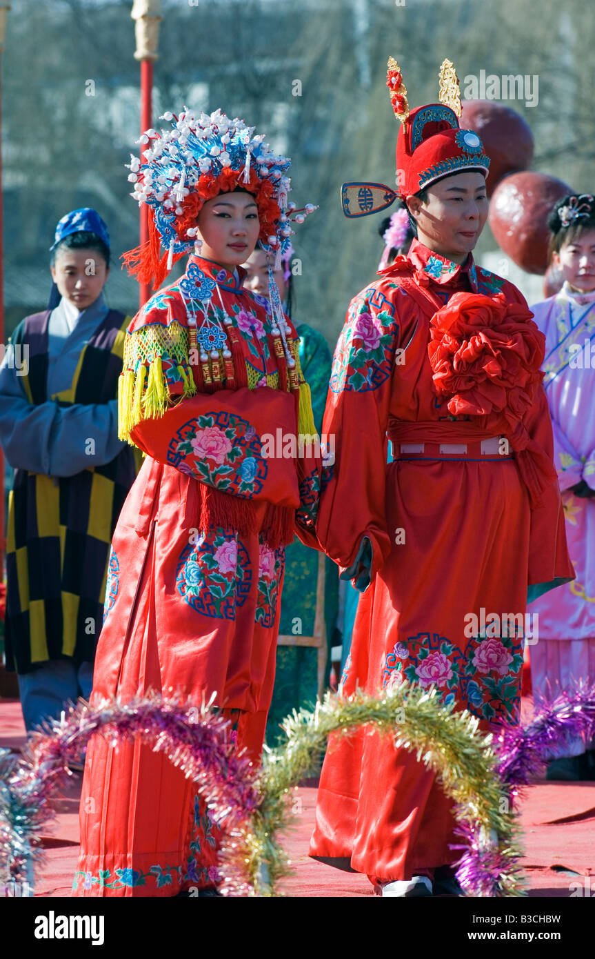 China, Beijing. Chinese New Year Spring Festival - Marriage ceremony celebrations at Daguanyuan Grand View Garden. Stock Photo